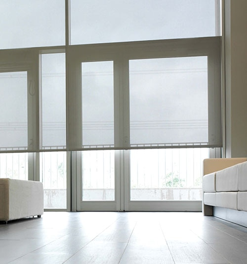 Boutique Motorized Solar Shades shown in White