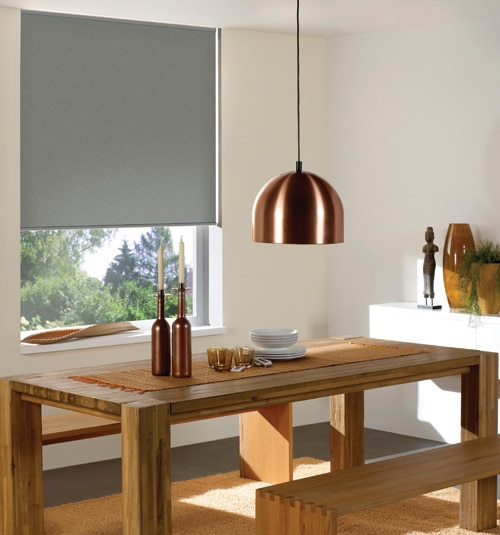 Blindsgalore® Reminiscent Vinyl Blackout roller shade shown in color Grey